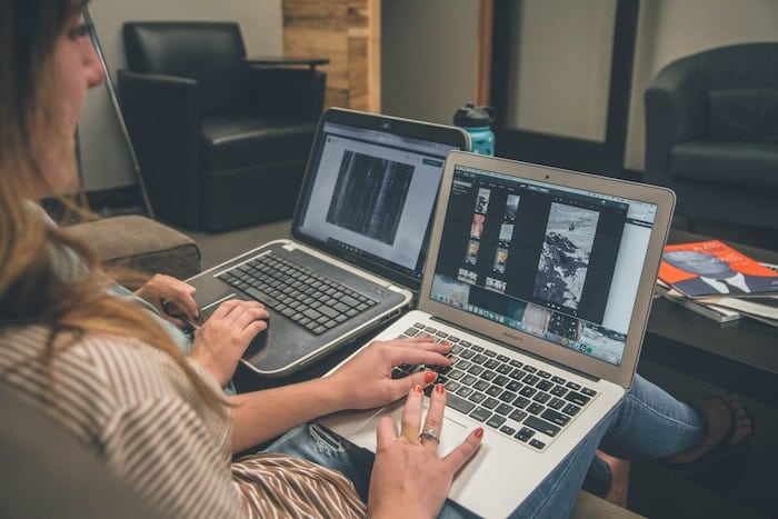 Woman editing images on laptop