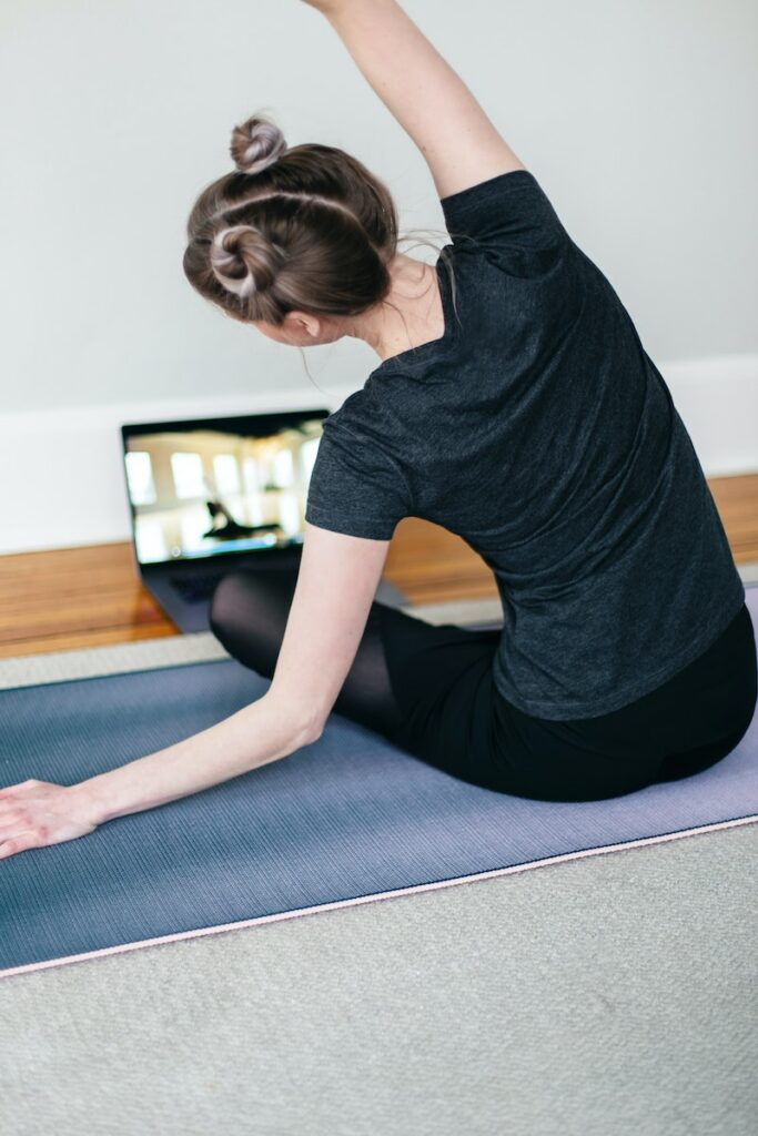 Woman doing an online yoga class at home